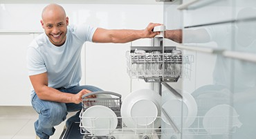 man fixing dishwasher