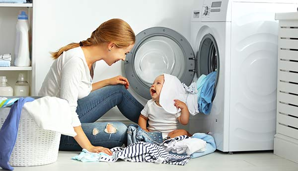 mother and baby at dryer